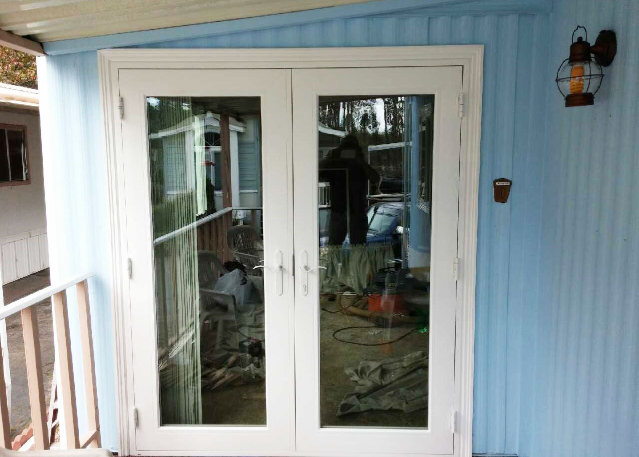 French-door-and-vinyl-siding-installation