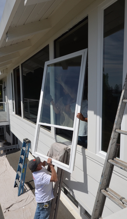 James-Sampson-in-action-installing-window